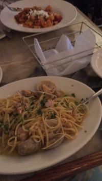 Spaghetti vongole in a white wine sauce.