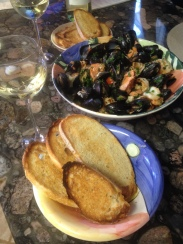 Easter seafood. Shrimp, mussels, and salmon in a white wine sauce.