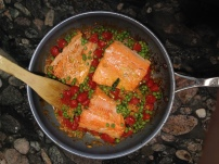 Salmon with cherry tomatoes and peas.