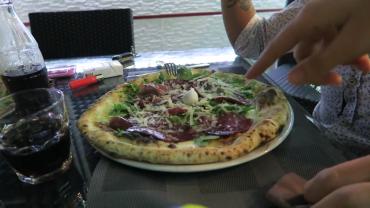 Neapolitan pizza with prosciutto and arugula.